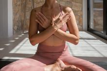 Crop Mindful Woman Meditating In Half Lotus Pose At Home