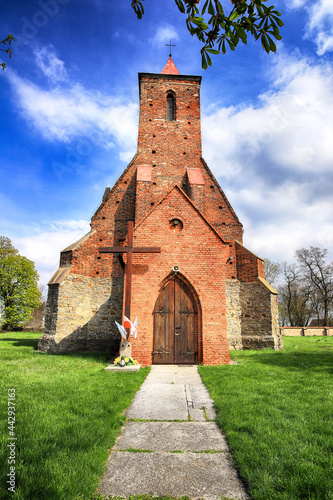 Carta da parati WROCLAW, POLAND - MAY 01, 2021: Roman Catholic Church of the Assumption of the Blessed Virgin Mary (15th century) in Wilczkow near Wroclaw, Poland, Europe