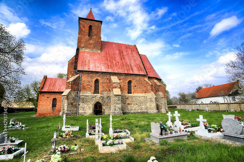 Fotografia WROCLAW, POLAND - MAY 01, 2021: Roman Catholic Church of the Assumption of the Blessed Virgin Mary (15th century) in Wilczkow near Wroclaw, Poland, Europe