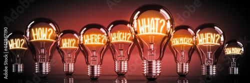 Obraz na plátne Questions concept - shining light bulbs - 3D illustration