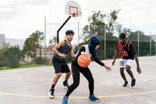 Diverse People Playing Basketball On Court