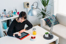 Woman Drawing On Tablet At Home