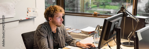Young phd student studying writing final paper for exam at university Fototapet