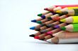Colored crayons against a white background