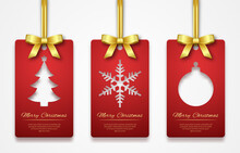 Christmas Tags On White Background With Golden Ribbon. New Year Holidays Hang Tag Labels. Cut Out Paper Christmas Tags With Tree, Snowflake And Ball