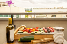 Grilled For Two On The Terrace Of A European City With Peppers, Zucchini, Cherry Tomatoes, Mushrooms, Chorizo And Sausage With Blood Sausage