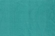 Closeup Of Green Textile. Fabric Details Backdrop