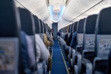Interior Of A Passenger Plane, Passage Between The Seats.