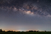 Milky Way With Stars Over Rice Field.with Grain And Select White Balance.White Clouds Obscured And Disturbed.Many Stars Over Sunrise.