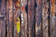 A Background Of Rectangular Logs, Vertically Stacked Tightly To Each Other, With Traces Of Paint And Bullet Holes.