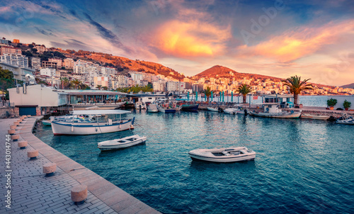Fantastic spring cityscape of Saranda port. Captivating Ioninian seascape. Wonderful evening scene of Albania, Europe. Traveling concept background.