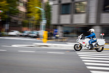 Unidentified Japanese Traffic Police Is Riding The Motorcycle On The Road. The Picture Is Panning To His Motion.