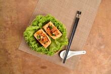 Chinese Hakka Deep Fried Bean Curd Tofu (tau Kua) With Minced Meat & Vegetable In Bamboo Basket On Wood Table Asian Traditional Halal Menu