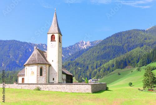 Fototapeta Old catholic church in the Swiss Alps