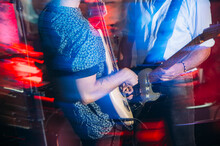 Bass Player Playing On Stage