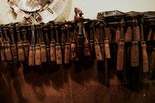 Luthier Artisan Tools Hanging On Wall In Workshop