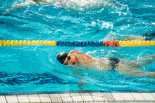Paralympic Swimmer Training In Pool