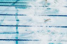 People Diving In Water Of Pool