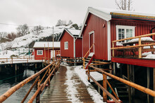 Wooden Quay With Cabin Houses On Winter Day