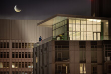 Couple Standing On A Roof Terrace Dancing At Night, Los Angeles, California, USA