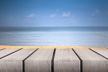 Wood Perspective On Sea Image Background. Empty Top Of Wooden Table. Wood Table Top On Blurred Blue Sea