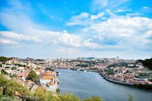 City Of Porto Around Duero River, Portugal. Sunny Cloudy Day