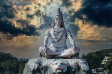 Statue Of Meditating Hindu God Shiva On The Ganges River At Rishikesh Village In India