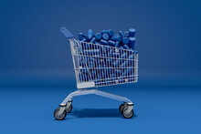 Concept Of Plastic Bottles And Blue Cans In A Supermarket Cart.