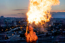 Fire-eater Artist Performing Spit Fire At Sunset