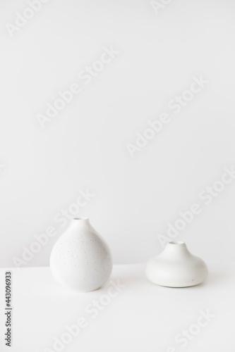 Fotografering White Ceramic Chicken Figurine on White Surface