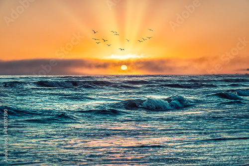 Dramatic and moody Atlantic Ocean sunset in Cape Town, South Africa Fototapet