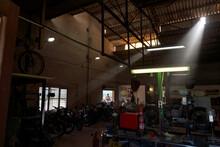 Dark Shabby Garage With Motorcycles