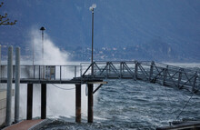 Waves Crashing On The Pier On Windy Lake Maggiore, Ticino