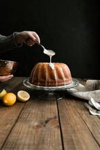 Crop Hand Icing A Lemon Sponge Cake