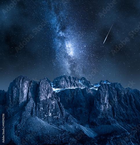 Tela Milky way and falling stars over Passo Gardena in Dolomites