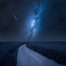 Milky Way Over Country Road In Summer.