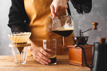 Barista Making A Drip Coffee, Pouring Finished Hot Coffee Into A Glass