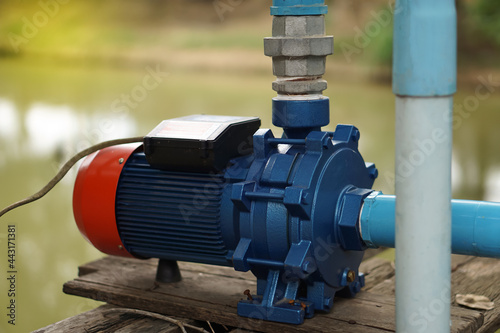 Fototapeta Water pump motor for Water supply system from pool to agriculture area  of the rural villager in Thailand