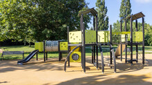 Empty Children Playground With Slide And Climbing Bars Activities In Public Green Park Modern