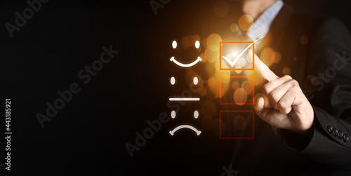 Fotografia, Obraz Customer service and Satisfaction concept ,Businessman pressing smiley face emoticon on virtual touch screen