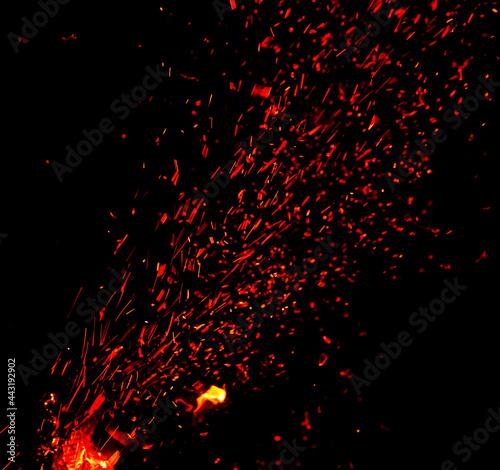 Fényképezés Sparks from fire on a black