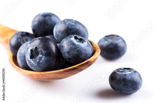 Fotografering Blueberries on white background