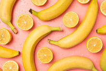 Top View Photo Of Ripe Unpeeled Bananas Lemon Halves And Water Drops On Isolated Pastel Pink Background