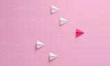 Fototapeta Kawa jest smaczna - Women's leadership concepts with red paper airplane leading among white on pink background.