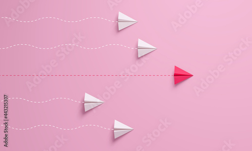 Canvas Women's leadership concepts with red paper airplane leading among white on pink background