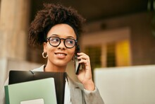 Young African American Businesswoman Smiling Happy Talking On The Smartphone At The City.