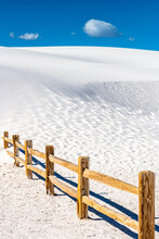 Sand Dunes Take Over Wooden Fence
