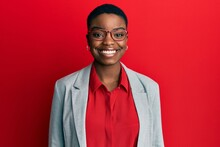 Young African American Woman Wearing Business Jacket And Glasses With A Happy And Cool Smile On Face. Lucky Person.