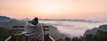 Young Couple Traveler Looking At Sea Of Mist And Sunset Over The Mountain At Mae Hong Son, Thailand, Banner Panorama