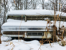 Snow Covered Old Chevy In Field